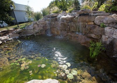 Natural boulder waterfall and pond water feature by Frederick Landscaping Maryland