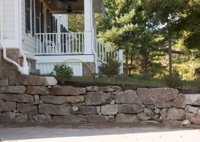 Dry-laid stone retaining wall hardscaping by Frederick Landscaping Maryland