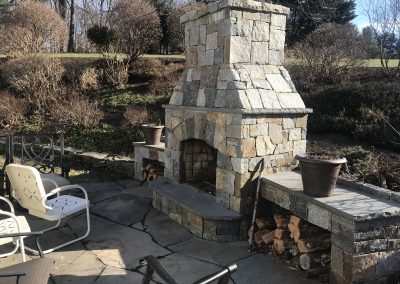 Stone fireplace hardscaping by Frederick Landscaping Maryland