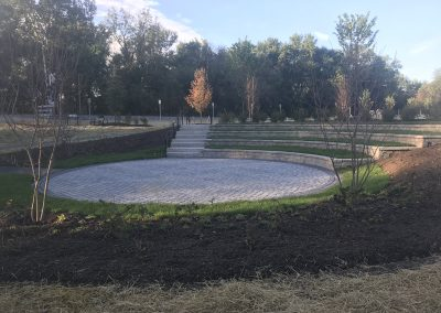 Permeable paver amphitheater with seating and landscape planting located in Point of Rocks MD by Frederick Landscaping Maryland