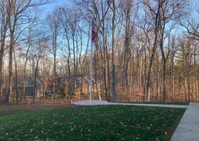 Hardscaped flagpole platform by Frederick Landscaping Maryland