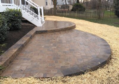 Semi-circular stonework patio by Frederick Landscaping Maryland