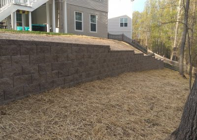 retaining wall for steep yard making space for kids to play