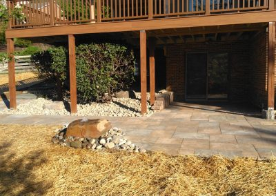 Patio walkout constructed with Belgard Origins 18 Pavers with adjacent boulder bubbler fountain water feature